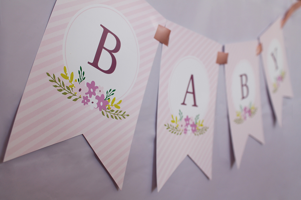 floral baby shower banner in pink for a girl